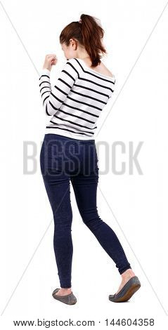back view of woman funny fights waving his arms and legs. Girl in a striped sweater boxing.
