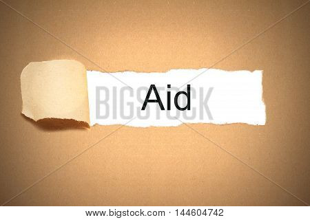brown package paper carton torn to reveal white space aid