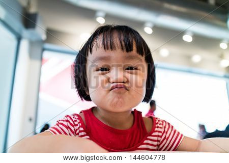 Asian Chinese Little Girl Showing Funny Expression