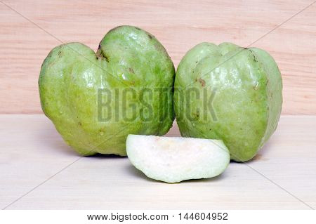 Guava Fruit And Half Piece Isolated On Wood Background