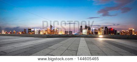 illuminated hangzhou qianjiang new city from empty brick floor