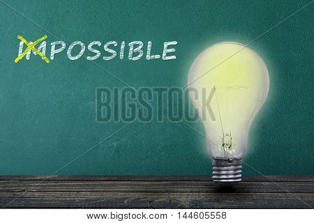 Impossible text on green board and light bulb on table