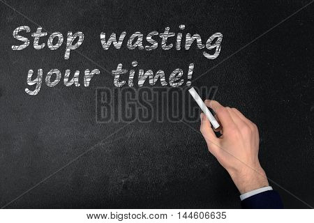 Stop wasting your time text write on black board