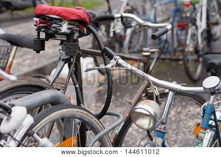 Closeup of various old bicycles at parking lot