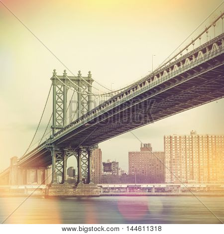 Cityscape of the Manhattan Bridge and New York City in the background, NYC, USA. Retro vintage style design