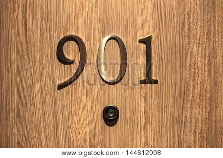 Hotel door and number close up image