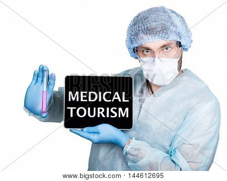 internet technology and networking in medicine concept. Doctor in surgical uniform, holding test tube and digital tablet pc with medical tourism sign. Isolated on white.