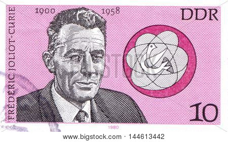 GERMANY - CIRCA 1980: a stamp printed in Germany showing Frederic Joliot-Curie, French Physicist, circa 1980
