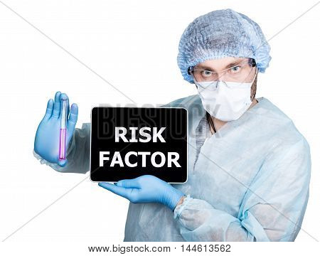 Doctor in surgical uniform, holding test tube and digital tablet pc with risk factor sign. internet technology and networking in medicine concept. Isolated on white.