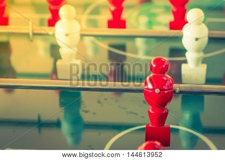 Football table game with red and white player ( Filtered image processed vintage effect. )