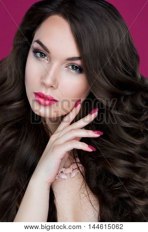 Beauty portrait of beautiful lady with bright makeup, gold, bright fuchsia lips. Beauty, fashion, grooming. Stylish makeup, long eyelashes, look in the camera