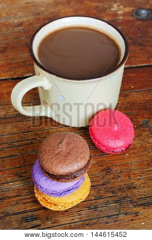 Cup Of Coffee With Milk And Macarons