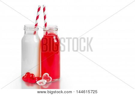 Two Retro Bottles With Striped Straws