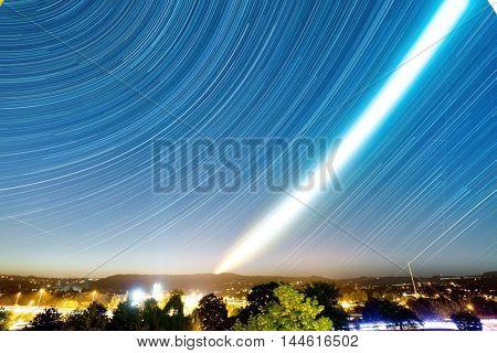 star trails on blue night sky