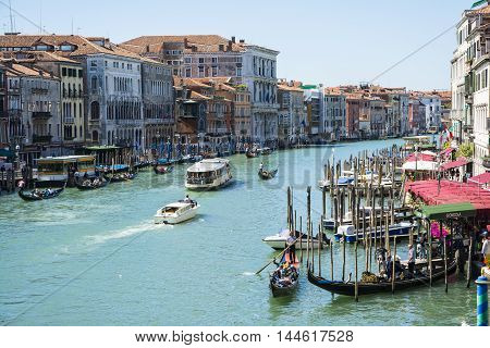VENICE,ITALY-AUGUST 17,2014:view from hight of grand canal with boat and gondolas in Venice during a summer day.