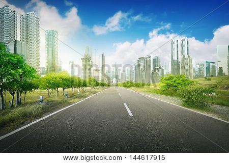 Empty road in the city on the daytime blue sky and city background