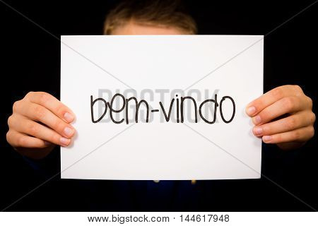 Child Holding Sign With Portuguese Word Bem-vindo - Welcome