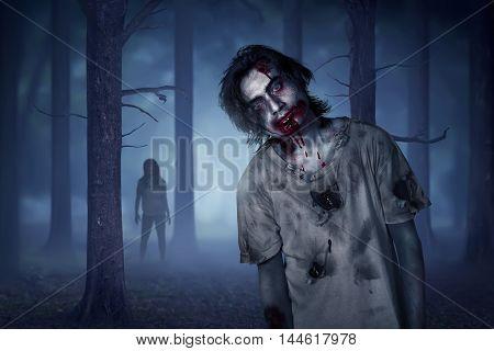 Asian Zombie Man Walking In Misty Forest