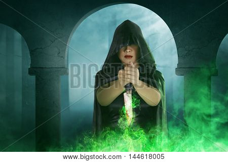 Asian Witch Woman Holding Knife With Green Light