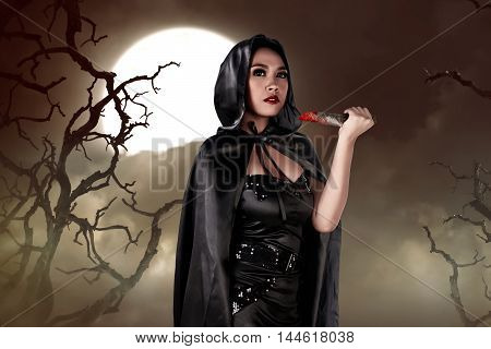 Young Asian Witch Woman Holding Knife