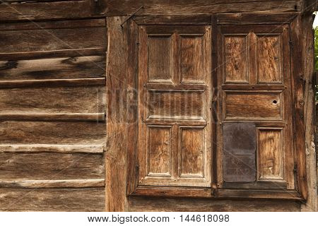 closed window of an old wooden house