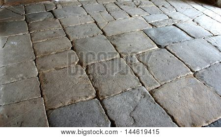 old grey stone floor of an ancient house