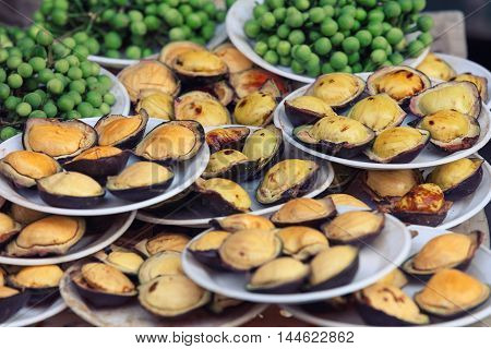 Traditional asian street food stall full of exotic snacks
