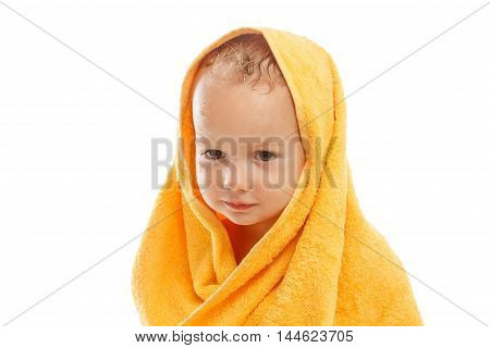 Happy baby wearing yellow towel sitting after bath or shower isolated on white. Clean dry child in bedroom. Bathing and washing of little kids. Children hygiene. Textile for infants.