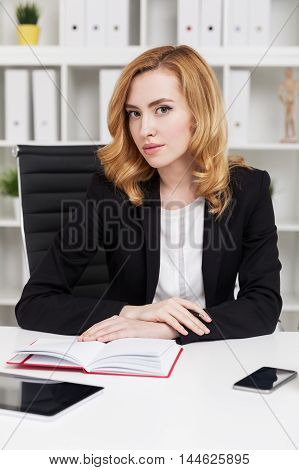 Serious businesswoman at workplace looking not content with her subordinate. Concept of strict boss and corporate work