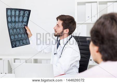 Doc Looking At X Ray Image