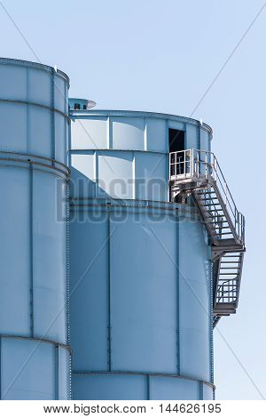 Staircase on external blue chemical silos plant
