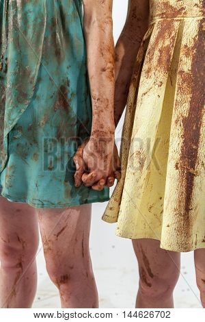 Two Hand In Hand Women In Dirty Dresses Spoiled With Chocolate