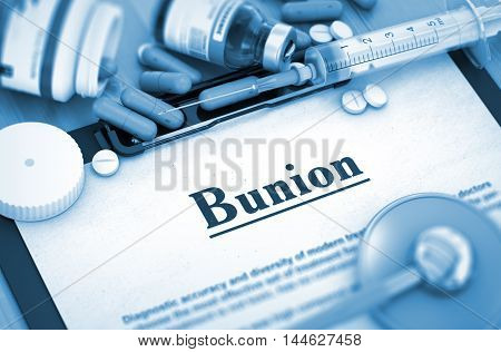 Diagnosis - Bunion On Background of Medicaments Composition - Pills, Injections and Syringe. 3D Render.