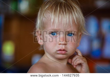 beauty blonde young boy with blue eyes in thailand