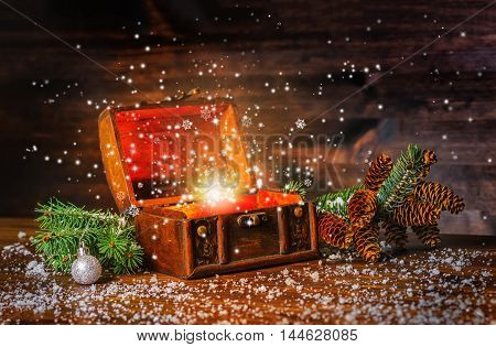 Christmas Winter Fairy With Fantasy Miracle In Opened Chest Treasure. Background Of Mystery Gift New