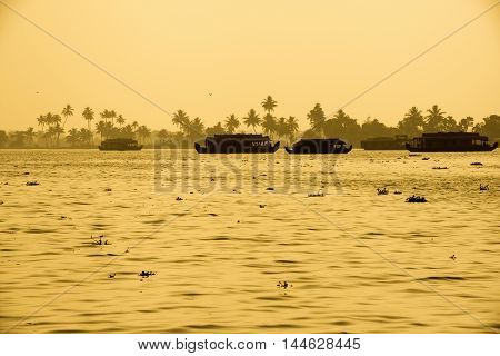 Beautiful Sunset Landscape With Houseboats At Backwaters Kerala And Silhouette Of Palm Trees, Travel