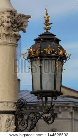 Antique lamp post near Lviv State Academic Opera and Ballet Theatre. Theatre was built in classical tradition of Renaissance and Baroque architecture (Viennese neo-Renaissance style). Ukraine