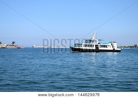 SEVASTOPOL RUSSIA - JULE 12.2016: pleasure boat sails near the waterfront