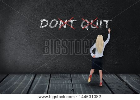 Don't Quit text write on black board