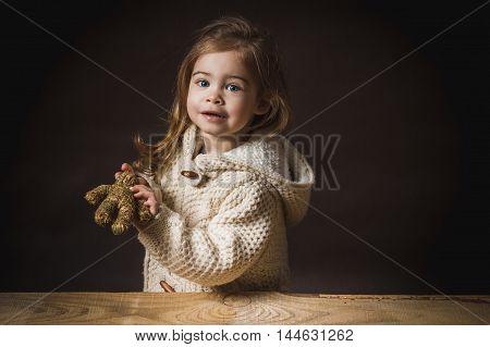 cute little girl enjoys the straw bear