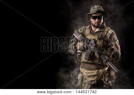 Special forces operator. Soldier with assault rifle.