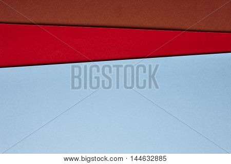 Colored cardboards background in blue red brown tone. Copy space. Horizontal