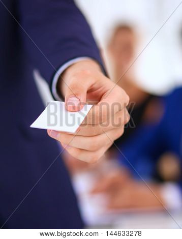 Closeup of a business man standing with card .