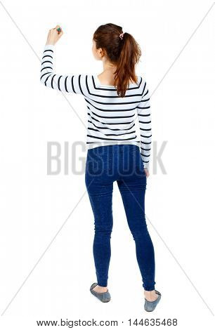 back view of writing beautiful woman. Girl in a striped sweater thoughtfully draws a pen.