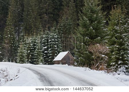 Wooden hut in the mountains in winter