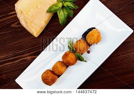 Cheese Croquettes (cheese Breaded Camembert With Berry Sauce)