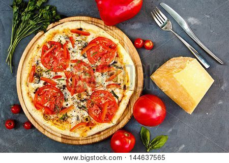Fresh Hot Pizza With Parmesan Cheese,bell Pepper, Parsley And Tomatoes
