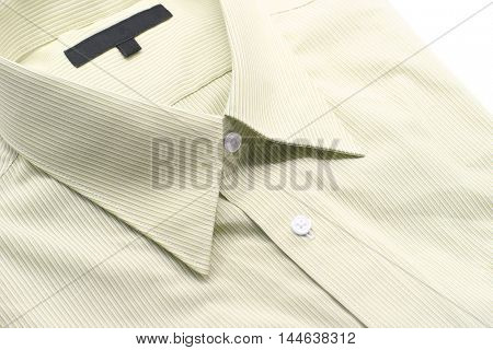 Close up view of a generic yellow business shirt with a line pattern