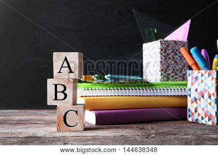 Word ABC and stationery set on blackboard background