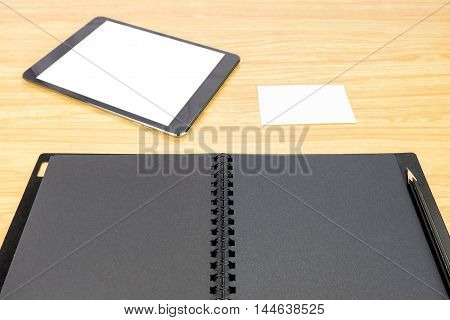 Pencil On Blank Black Book With Table And Business Card On Wooden Table, Mock Up For Adding Your Con
